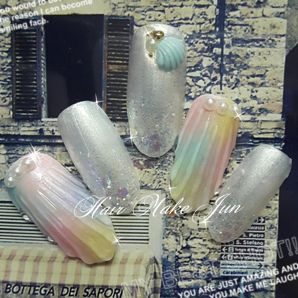 nailist.mioさんのネイルデザインの写真。テーマは『夏デザイン、マリンネイル、夏ネイル、HairMakeJun、貝がらネイル、人魚の鱗』