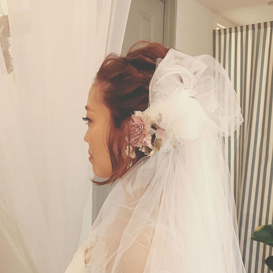 浦川 由起江さんのヘアスタイルの写真。テーマは『ブライダルヘア、ヘアアレンジ、ブーケ』
