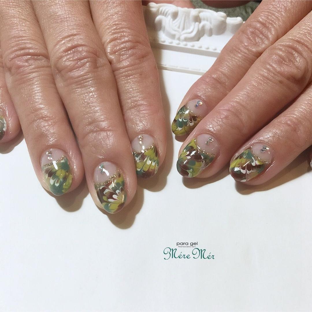 Satomi Kawamitsuさんのネイルデザインの写真。テーマは『nails、お正月、2018、トレンド、ラメ、ゴールド、ピーコック、フレンチ』