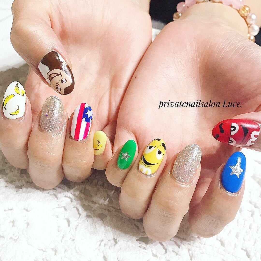 private nail salon Luce.さんのネイルデザインの写真。テーマは『ネイル、ジェルネイル、nail、💅、nailart、キャラクターネイル、キャラクター、痛ネイル、🙊、おさるのジョージ、m、チョコレート、手描きアート、POP、カラフル、国旗、星、🍌、Nailbook、tredina、nailistagram、simple、奈良、お友達ネイル、🏡、自宅サロン、お家ネイル、Luce.』