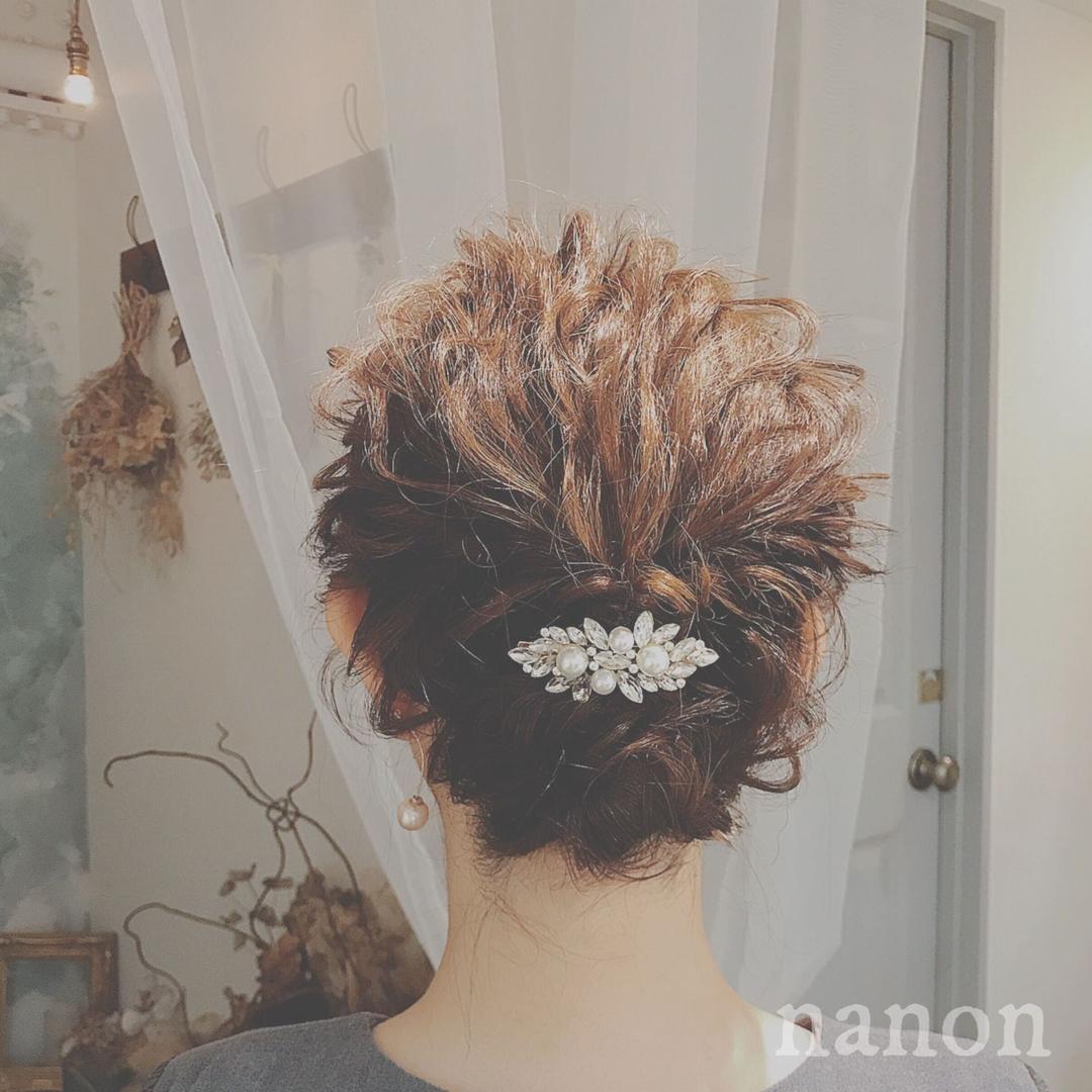 浦川 由起江さんのヘアスタイルの写真。テーマは『ブライダルヘア』