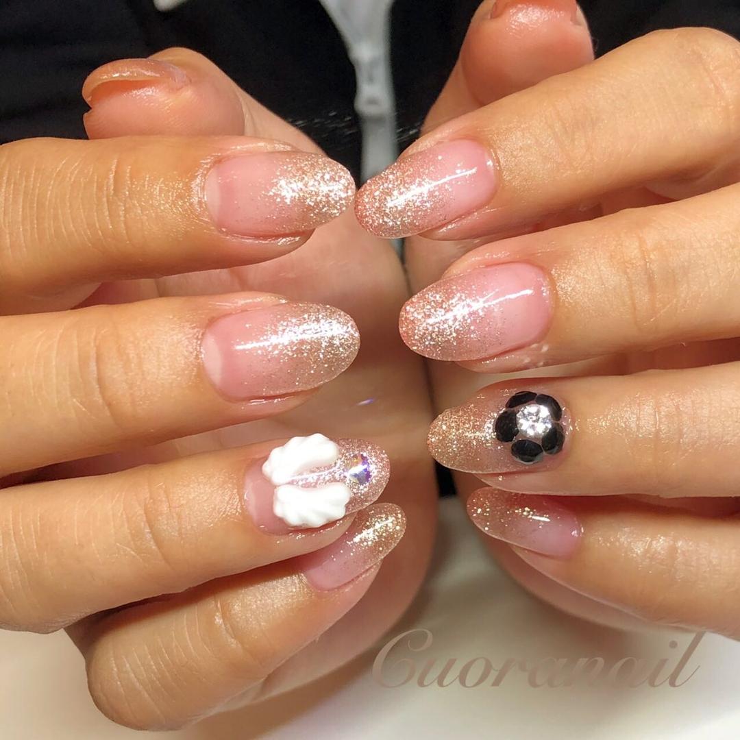 Cuoranailさんのネイルデザインの写真。テーマは『羽根ネイル、キラキラネイル、天使の羽、ビジューネイル、エンジェル、フィルイン、スワロフスキー、フラワーネイル、nail、nails、nailstagram、nailart、naildesign、sparkle、帯広ネイルサロン、帯広ネイル、帯広、札内、幕別、音更、音更ネイルサロン、obihiro、tokachi、hokkaido、おしゃれネイル』