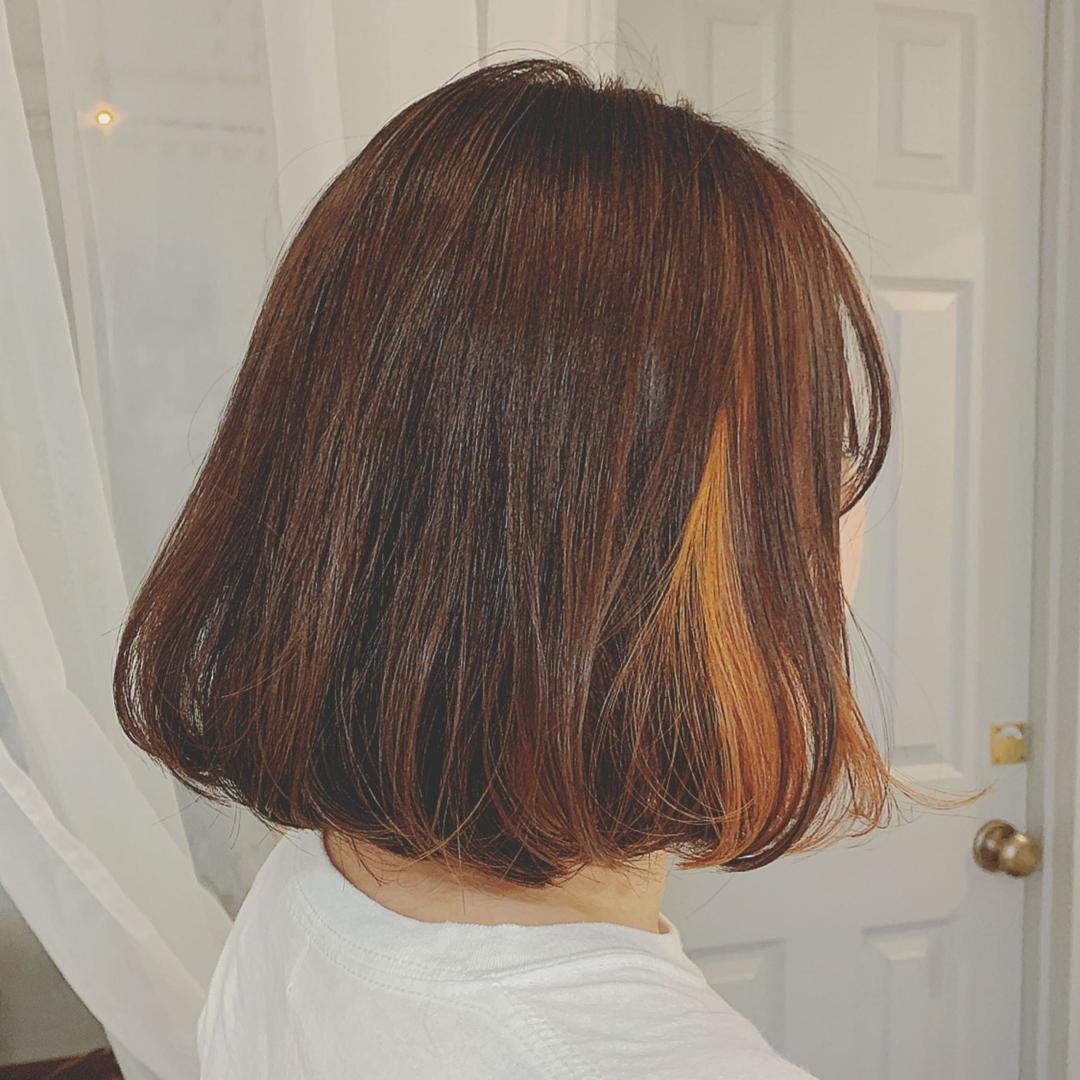 浦川 由起江さんのヘアスタイルの写真。テーマは『アプリコットオレンジ、インナーカラー、ボブ、プライベートサロン、nanon』